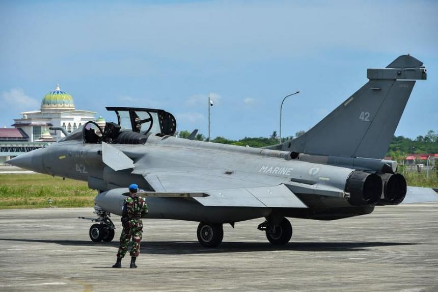 An Indonesian soldier stands guard near a French Rafale fighter jet at an air base in Blang Bintang, Aceh province, on May 19, 2019.