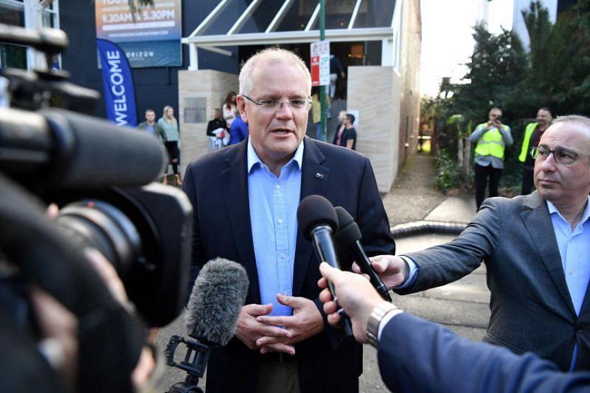 Australian Prime Minister Scott Morrison speaking to the media as he arrives at the Horizon Church in Sydney, Australia, on May 19, 2019.