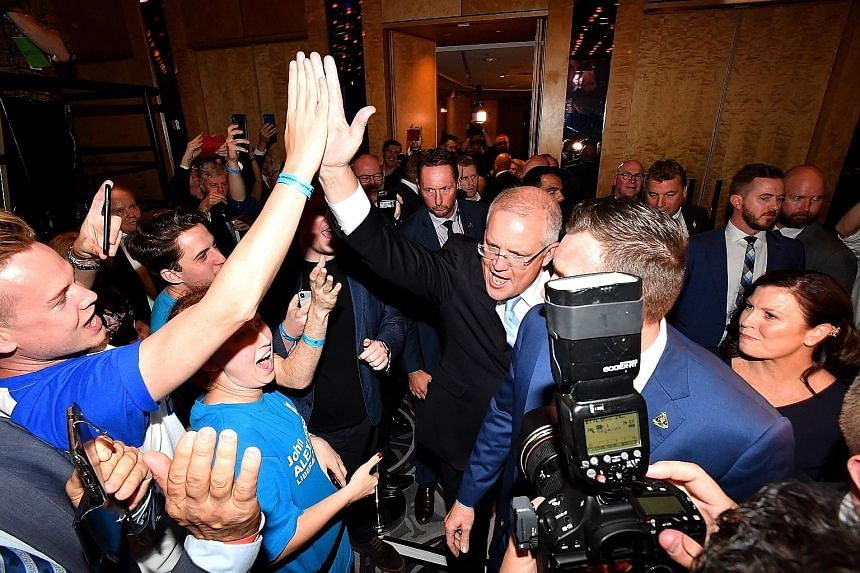 Australian Prime Minister Scott Morrison greeting supporters in Sydney after the ruling Coalition won in Saturday's polls. PHOTO: EPA-EFE