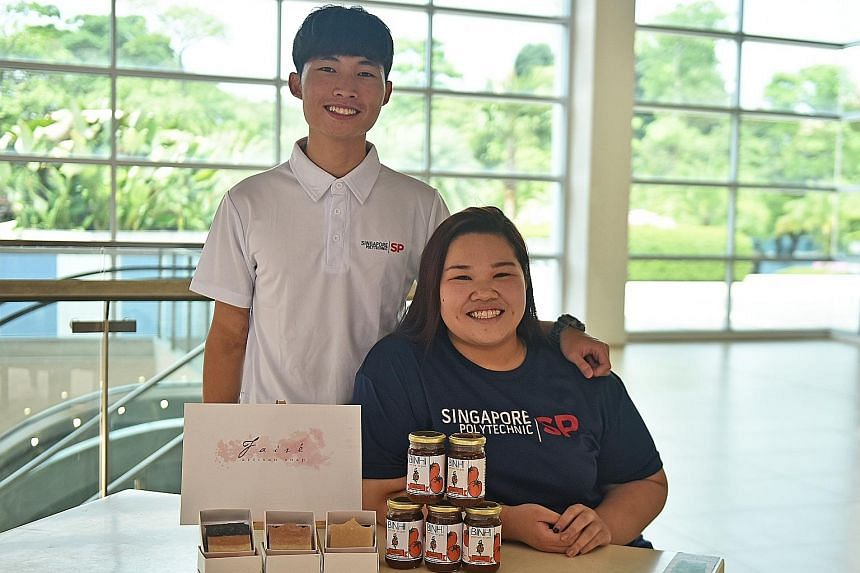 Singapore Polytechnic graduates Sieng Chun Hon, with his team's artisanal soap made using natural ingredients, and Joan Charlotte Tng, with her team's tomato jam that uses natural preservatives.