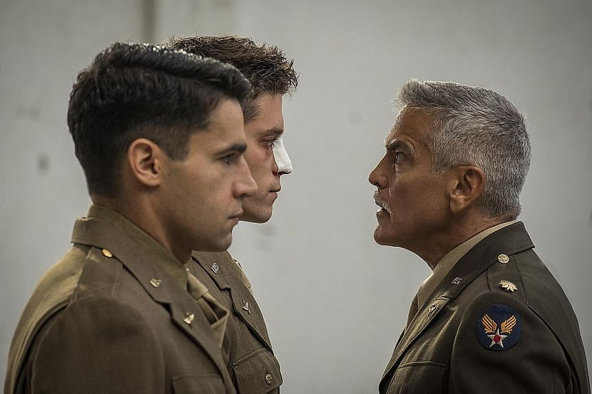 George Clooney's Lieutenant Scheisskopf (far right) glaring at Clevinger, a soldier played by Pico Alexander (with bandage on nose), and Yossarian, played by Christopher Abbott.