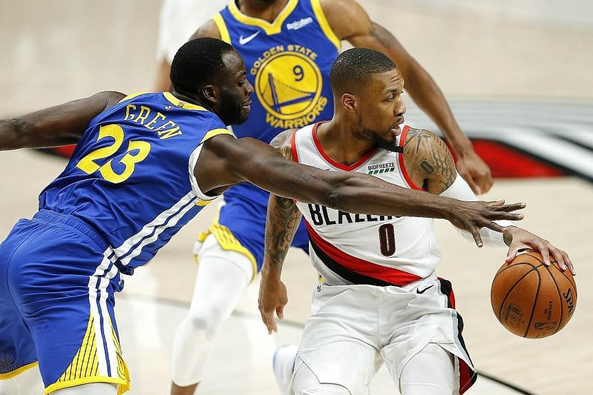 Golden State's Draymond Green getting in the face of Portland's Damian Lillard in Saturday's Western Conference Finals Game 3. Green was dominant in racking up his seventh career post-season triple-double.