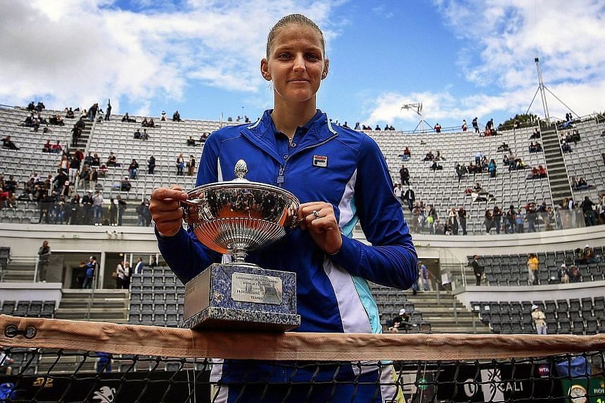 Karolina Pliskova posing with her Italian Open trophy after beating Johanna Konta 6-3, 6-4 in the final yesterday.