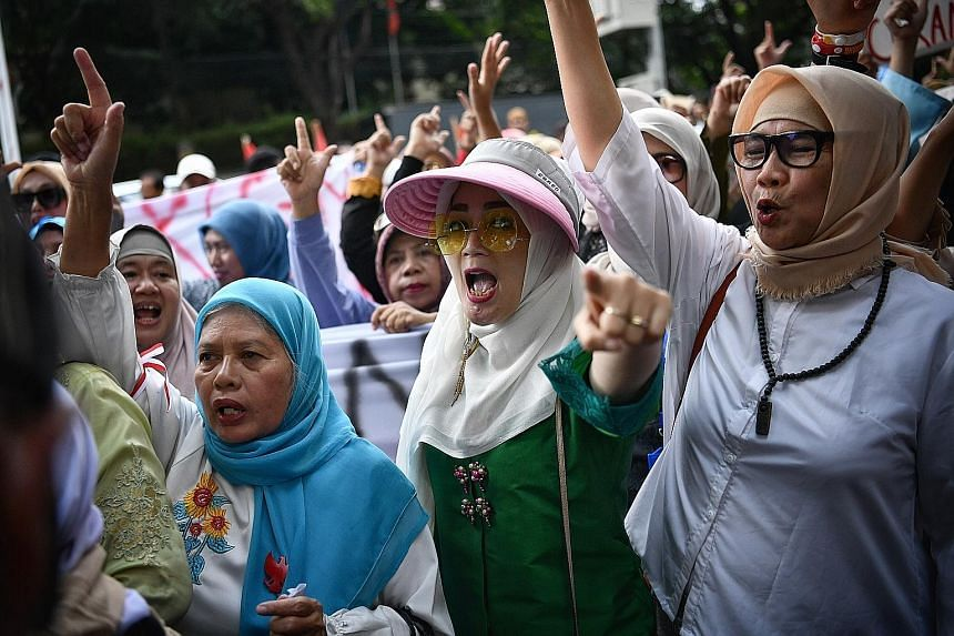 Supporters of presidential candidate Prabowo Subianto outside the KPU building on April 21. The Persaudaraan Alumni 212 group has called for a rally to protest against the impending poll results.