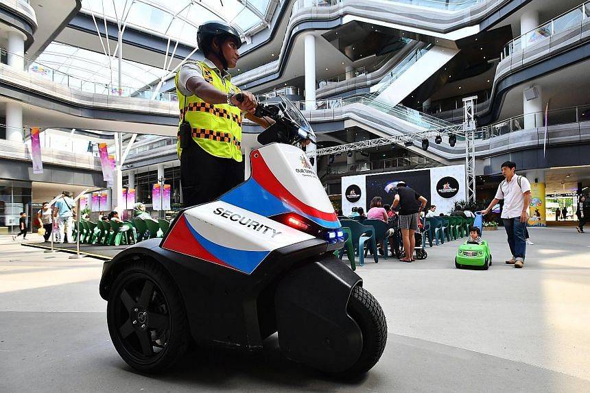 Security officer Mohamed Sidek patrolling Our Tampines Hub using a security Segway. Instead of armed power, the consensus among industry players is that it would be more effective to empower officers through better legal protection and to give the pr