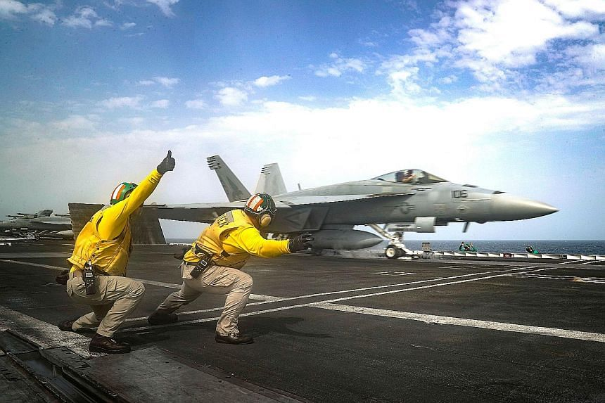 An F/A-18E Super Hornet shown here being launched from the flight deck of the Nimitz-class aircraft carrier USS Abraham Lincoln in the Arabian Sea last Thursday in a US Navy photo. Tensions in the Gulf have escalated significantly in recent weeks aft
