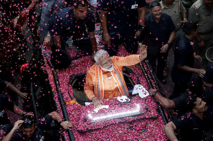 Exits polls showed Prime Minister Narendra Modi's National Democratic Alliance projected to win between 339 and 365 seats in the 545-member lower house of parliament.