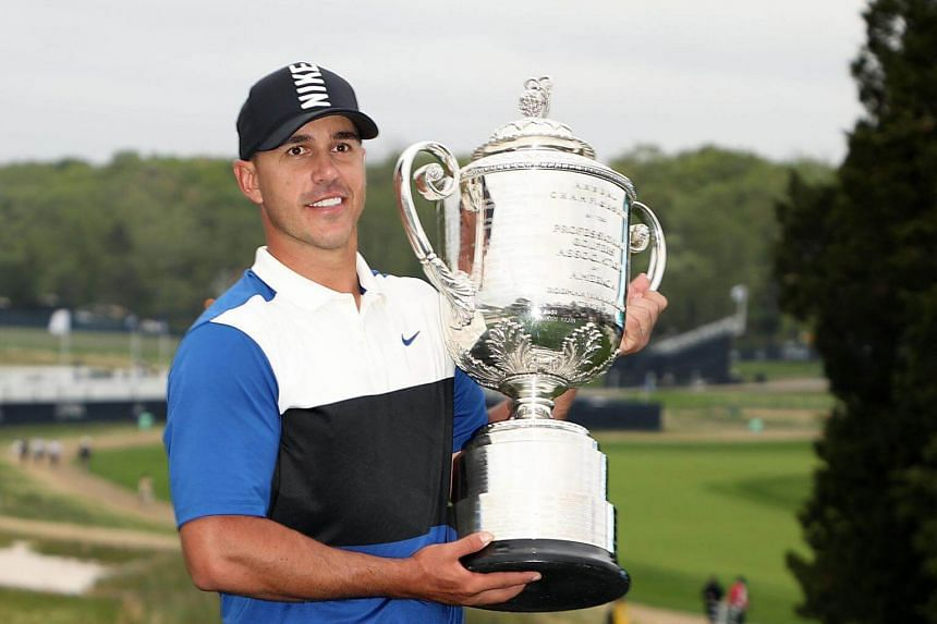 Brooks Koepka poses with the Wanamaker Trophy after winning the final round of the 2019 PGA Championship at the Bethpage Black course on May 19, 2019.