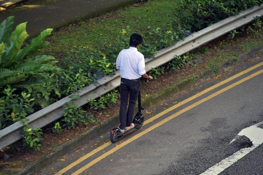 A man riding an e-scooter.