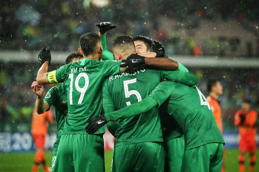 Beijing Guoan's players celebrate after scoring during the AFC Champions League group stage football match against Thailand's Buriram United in Beijing, on April 24, 2019.