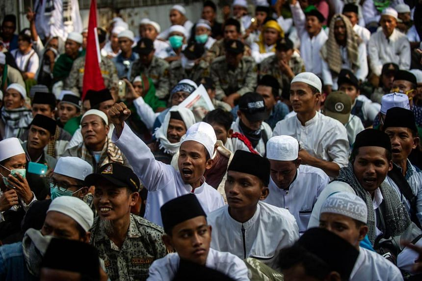 Supporters of Indonesian presidential hopeful Prabowo Subianto gather for a protest in Surabaya, on May 17, 2019.