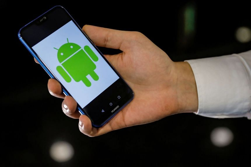 An Android logo is displayed on a Huawei smartphone