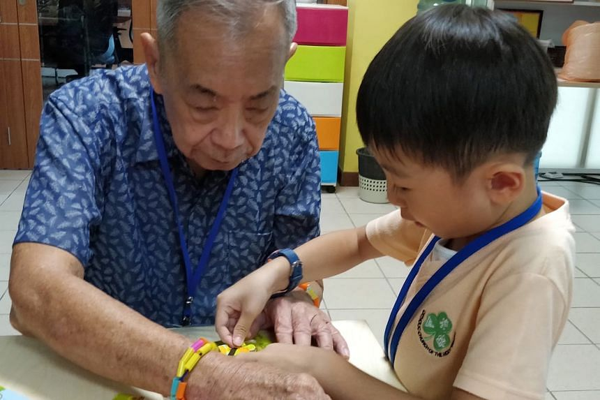 A pre-schooler from the Church of the Holy Trinity kindergarten interacting with a senior from Apex Harmony Lodge.