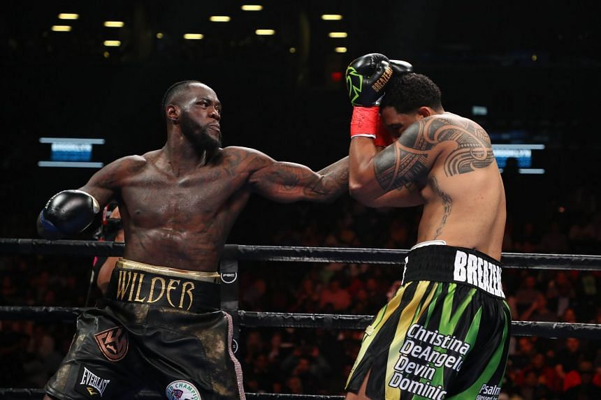 Deontay Wilder punishing Dominic Breazeale in Saturday's one-sided bout at the Barclays Centre in New York.
