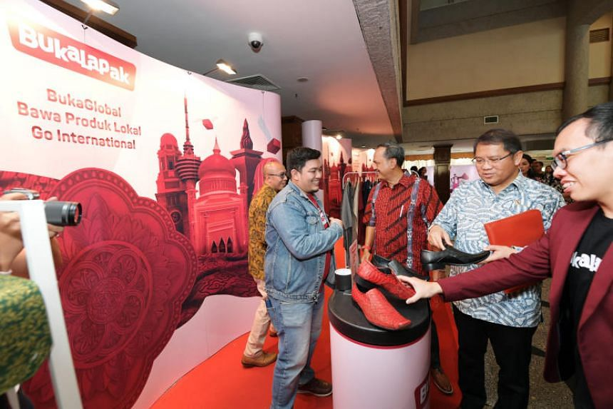 Indonesia's Minister of Communication and Information Technology Rudiantara (second from right) and Bukalapak co-founder and president Fajrin Rasyid (right) at the launch of the BukaGlobal app at the Indonesian Embassy in Singapore.