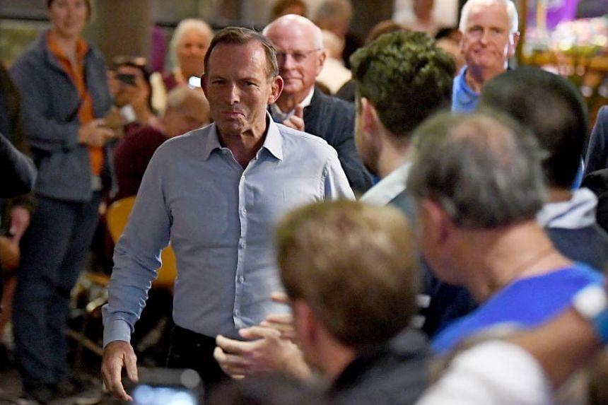 "Former Australian Prime Minister Tony Abbott, the self-described ""junkyard dog"" of Australian politics, lost his seat in Sydney."