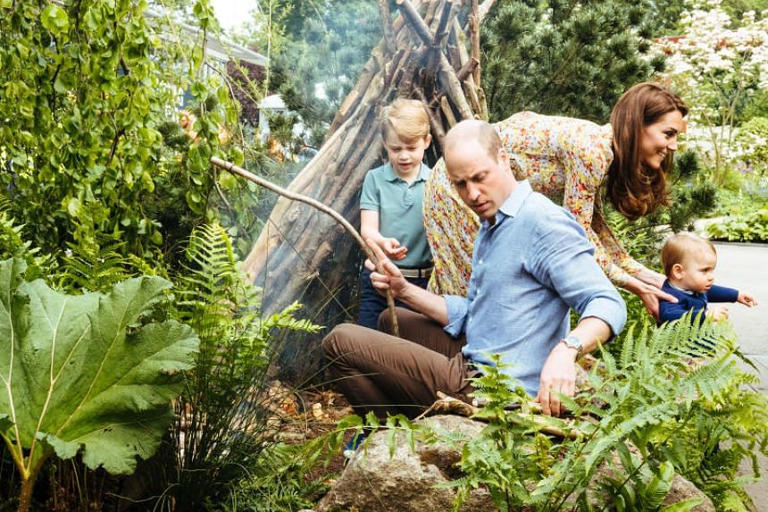 Britain's Prince William and his wife Catherine, Duchess of Cambridge, with their children Prince George and Prince Louis explore the Adam White and Andree Davies co-designed garden in London on May 19, 2019.