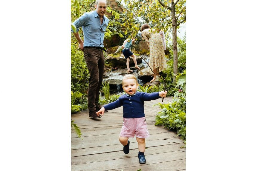Britain's Prince Louis, who celebrated his first birthday last month, can be seen walking for the first time and waving a stick.