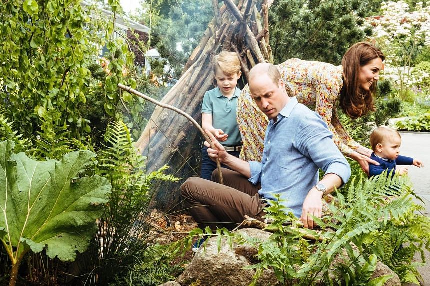 Prince William and his wife Kate with Prince George (left) and their youngest child, Prince Louis, visiting the garden co-created with landscape artists Andree Davies and Adam White ahead of the Chelsea Flower Show in London on Sunday. The couple's d