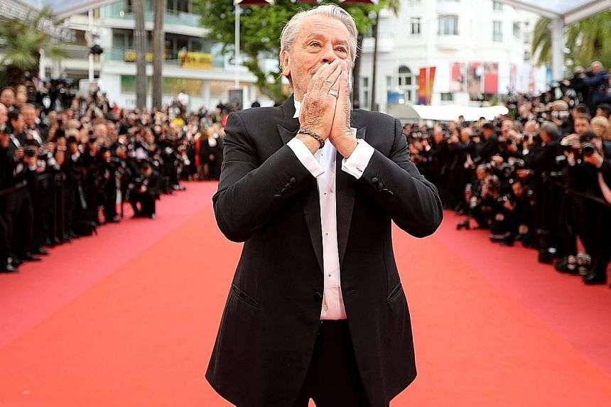 French actor Alain Delon received an honorary Palme d'Or in Cannes on Sunday despite claims of him abusing women.