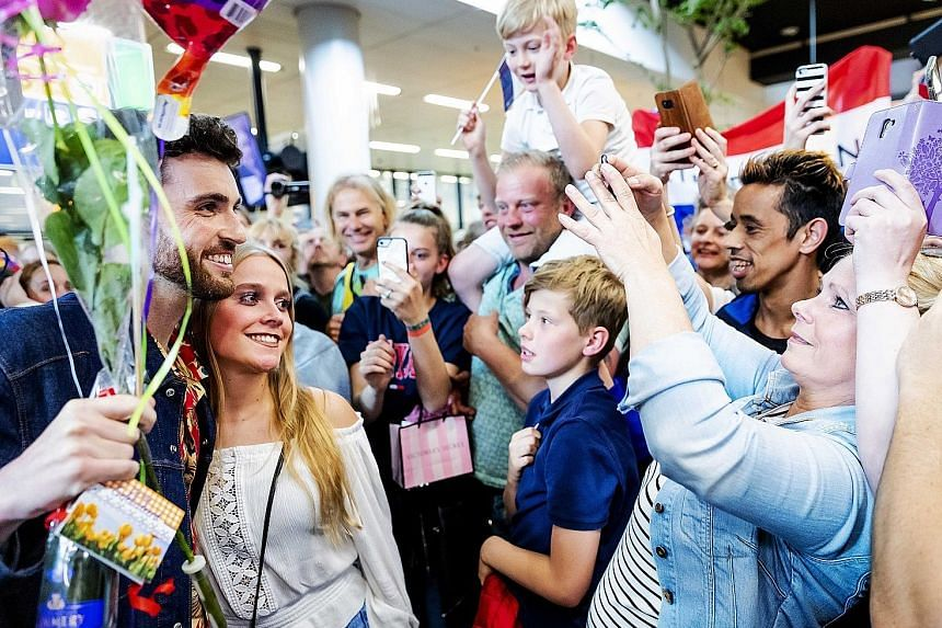Dutch singer Duncan Laurence (above) with fans at Amsterdam Airport Schiphol on Sunday. He won the Eurovision Song Contest with the song Arcade.