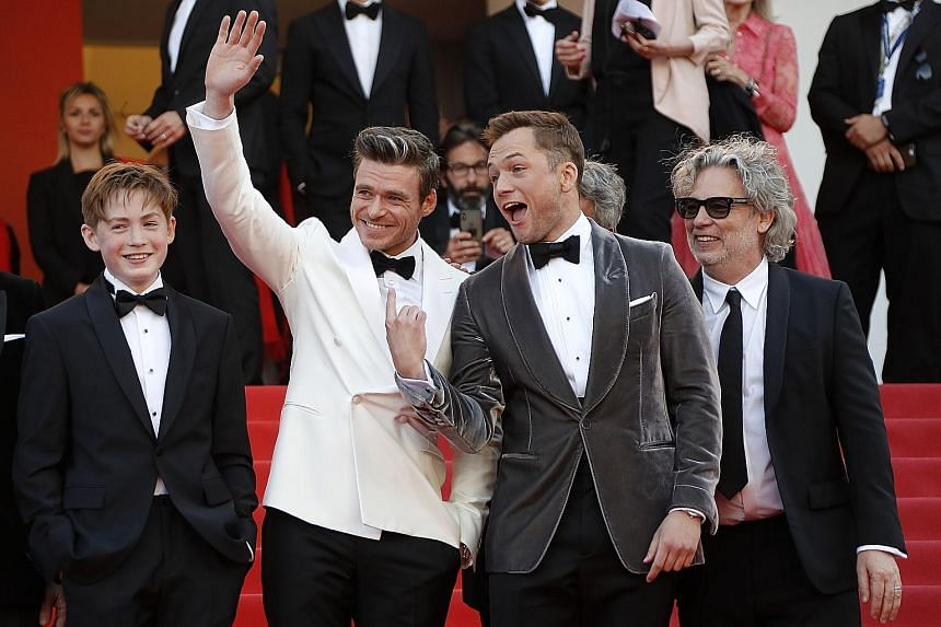 CHANNELLING 007: Is he the next James Bond? Scottish actor Richard Madden (far left, with British actor Taron Egerton) fuelled rumours with a string of Instagram poses in exotic settings typical of the world's favourite spy. According to Agence Fra