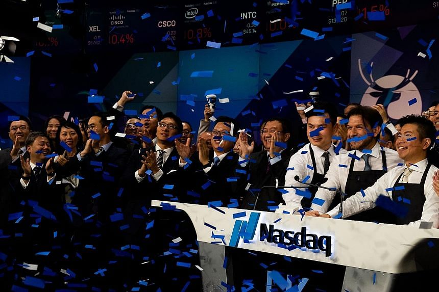 Luckin Coffee employees celebrating during the launch of the company's initial public offering on Nasdaq last week.
