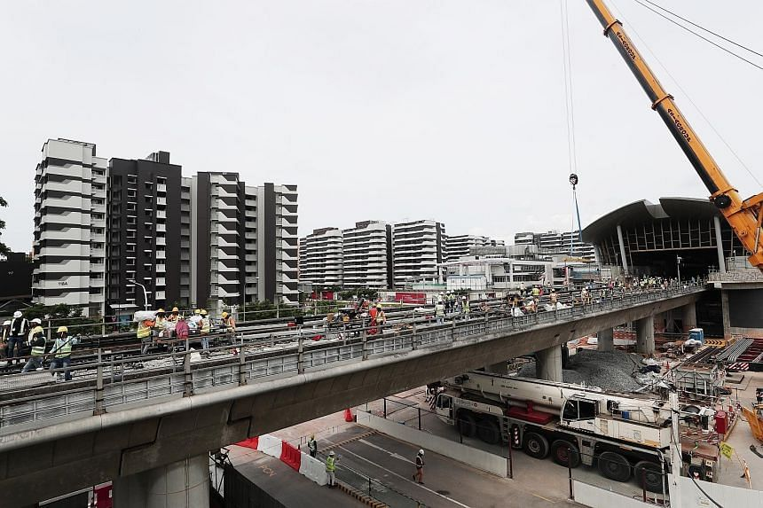 Construction of a crossover track near Canberra station yesterday. The station is a 10-minute walk from an estimated 17,000 homes in nearby estates such as Sembawang Springs. About 75 per cent of the construction work at the station has been complete