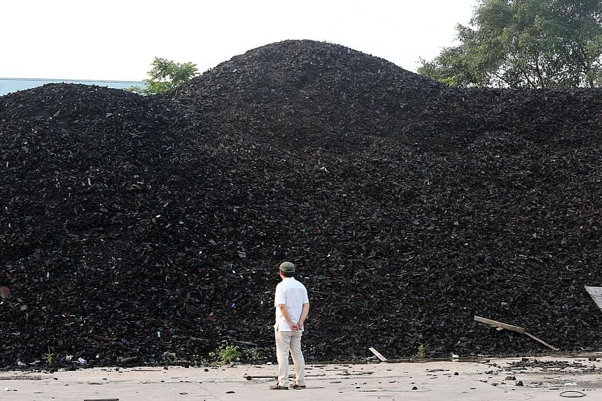 """The """"rubber hill"""" comprising scrap rubber materials was once meant for tyre-derived fuel and to be used in power plants and paper mills. PHOTO: LIANHE WANBAO"""