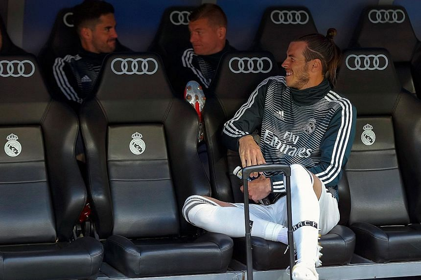Gareth Bale shares a joke as he warms the Real Madrid bench with Isco (left) and Toni Kroos during their last game of the season against Betis.
