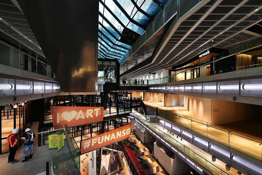 Extending from Basement 2 to Level 4, the 25m-tall Tree of Life is the centrepiece of the new Funan mall.
