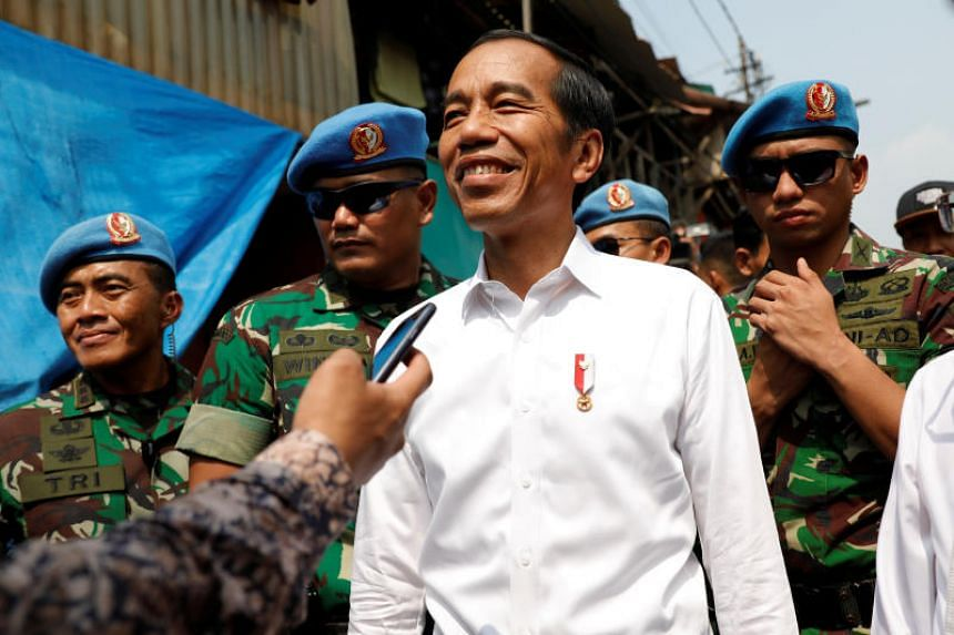 Indonesian president Joko Widodo reacts after making a public address at a rural area of Jakarta, Indonesia, on May 21, 2019.