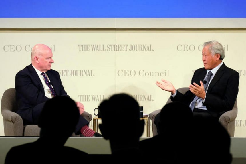 Singapore's Minister for Defence Ng Eng Hen (right) speaking with Wall Street Journal editor-at-large Gerard Baker, at the Wall Street Journal CEO Council Tokyo Meeting on May 21, 2019.