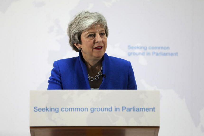 British Prime Minister Theresa May, delivers a speech setting out a new proposal for her Brexit deal in central London, on May 21, 2019.