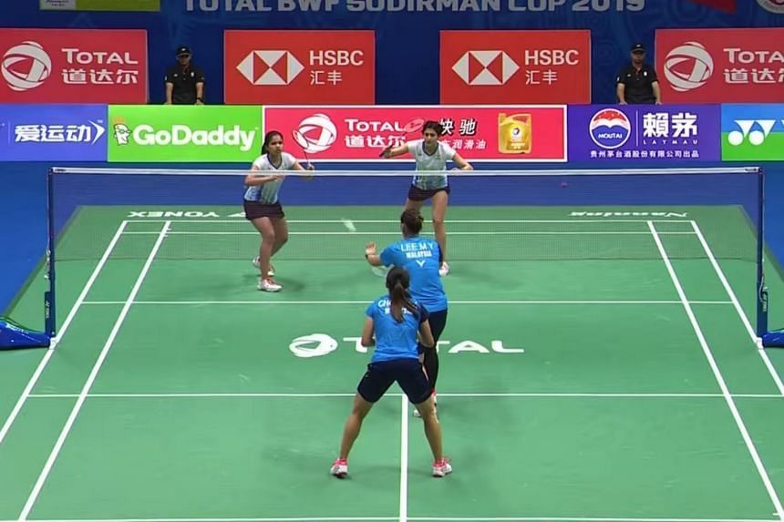 Malaysia's Chow Mei Kuan and Lee Meng Yean (in blue) against India's Ashwini Ponnappa and N. Sikki Reddy at the Sudirman Cup 2019.