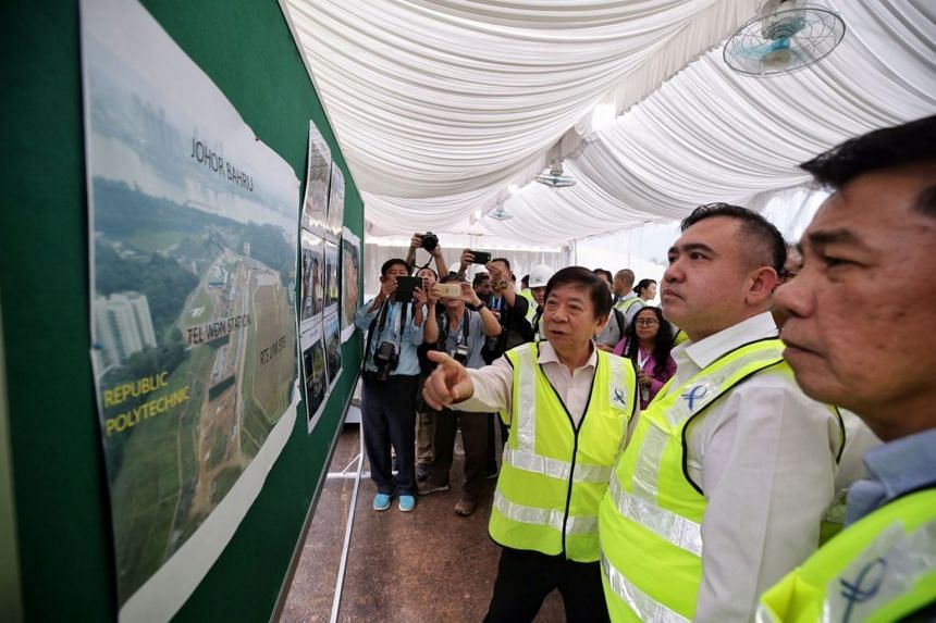 Singapore Transport Minister Khaw Boon Wan and Malaysian counterpart Anthony Loke looking at an aerial shot of the RTS Link site at Woodlands North, on May 21, 2019.