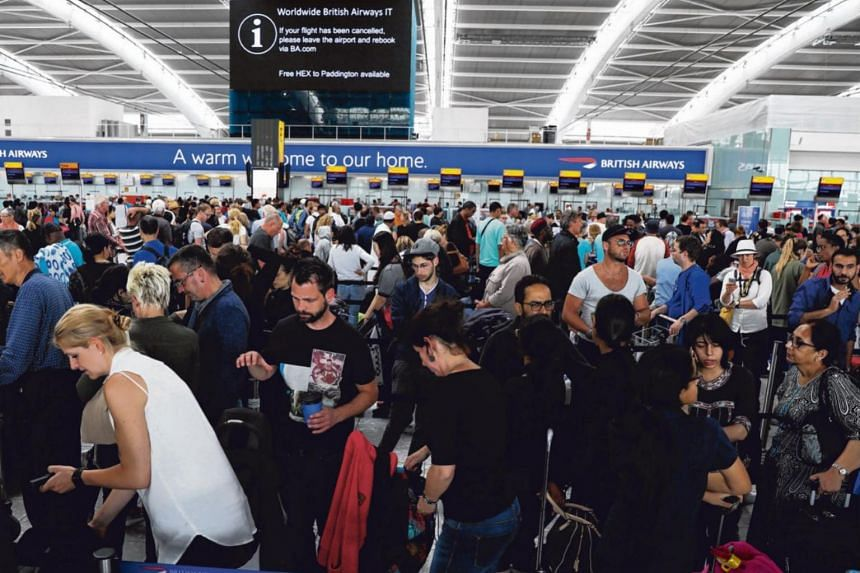 The crowd at the check in desks of London's Heathrow Terminal 5.