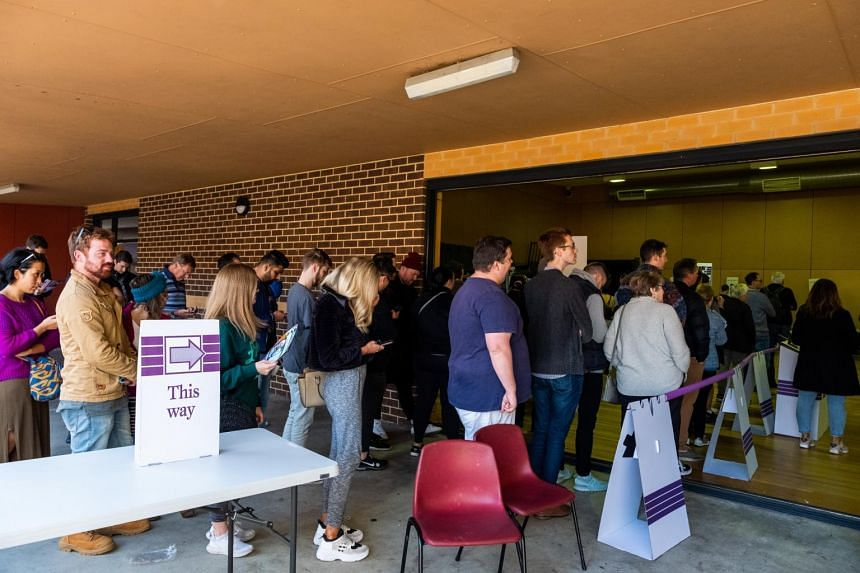 Voters line up at a polling station in Melbourne, Australia, on May 18, 2019.