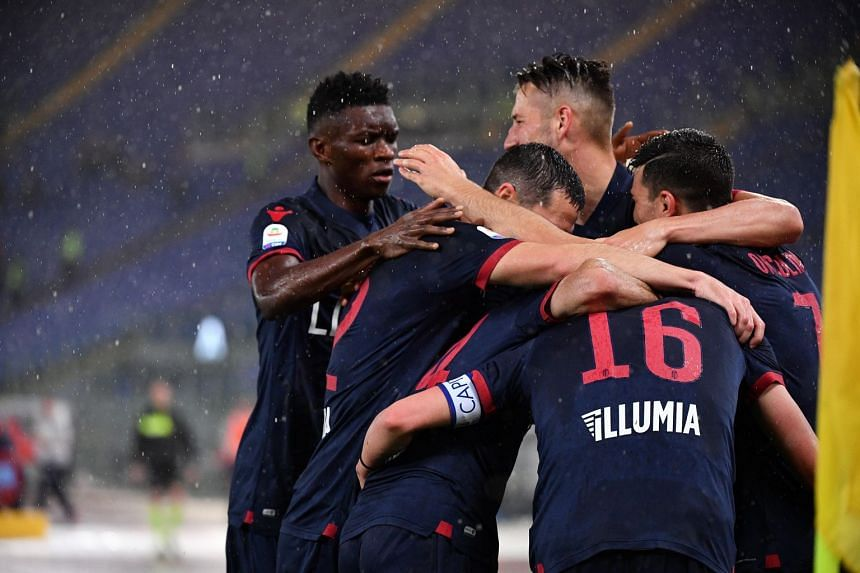Bologna players celebrate after scoring their side's first goal during the Italian Serie A soccer match between Lazio and Bologna at the Stadio Olimpico in Rome on May 20, 2019.