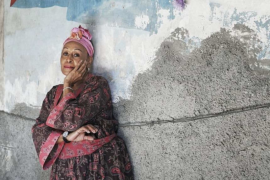 Omara Portuondo is a founding member of Cuarteto D'Aida, a female vocal group popular in Cuba in the 1950s and 1960s, and achieved worldwide fame late in her career with iconic Cuban group Buena Vista Social Club.