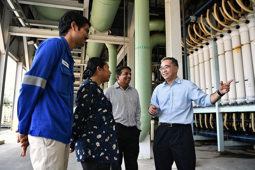 (From right) PUB's director of water supply (plants) Bernard Koh speaking to Tuaspring's senior manager for operations and maintenance (water) Krishnamoorthy Chandrasekar; senior quality environmental, health and safety manager Hamidah Mohd Razak; an