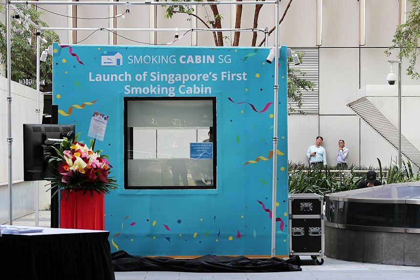 Singapore's first smoking cabin, which converts cigarette smoke into clean air, outside Fusionopolis in one-north, in Buona Vista. The cabin can fit up to 10 people at a time and utilises a three-layer filtration system.