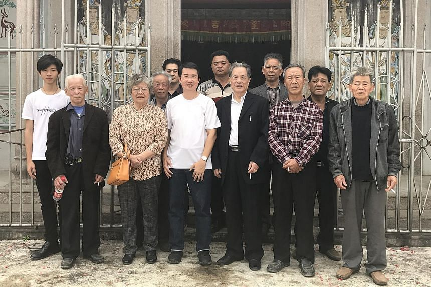 Mr Cyprian Lim (front row, in a white T-shirt) with his relatives in China. Mr Lim embarked on the book project as he was curious about his ancestors' faith and service to the Catholic community. The village of Peknay with its Catholic church. Some 3
