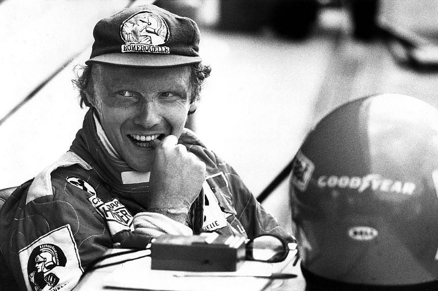 THE RACER: A bubbly Niki Lauda (above) before the 1977 German GP at Hockenheim. He won his second F1 world title that season with Ferrari and would clinch a third with McLaren in 1984. PHOTO: DPA THE MENTOR: Lauda, who returned to F1 in management ro