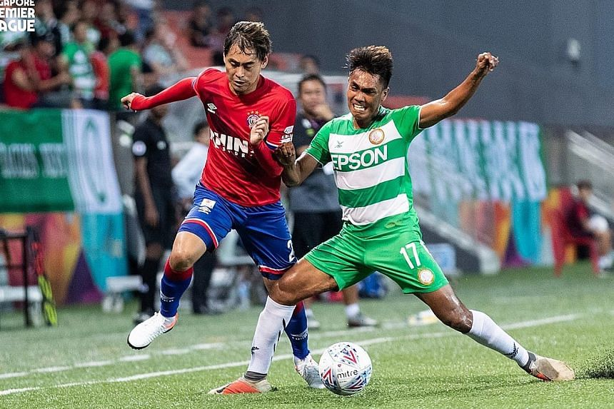 Warriors FC forward Gabriel Quak (in red) vying with Geylang International's Firdaus Kasman during a Singapore Premier League match last month. The Warriors are bottom of the standings, behind the Young Lions on goal difference. PHOTO: SINGAPORE PREM
