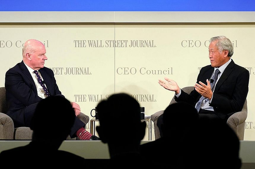 Defence Minister Ng Eng Hen speaking at The Wall Street Journal (WSJ) CEO Council meeting in Tokyo yesterday with moderator and WSJ editor-at-large Gerard Baker.