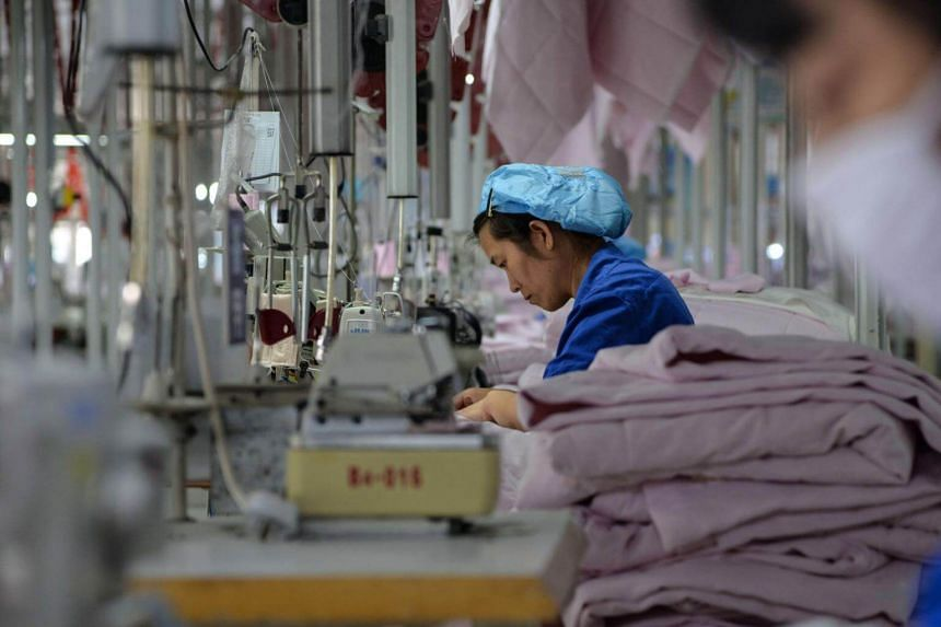 A Chinese employee works on manufacturing products that will be exported to the US at a factory in Binzhou, China, on May 17, 2019.