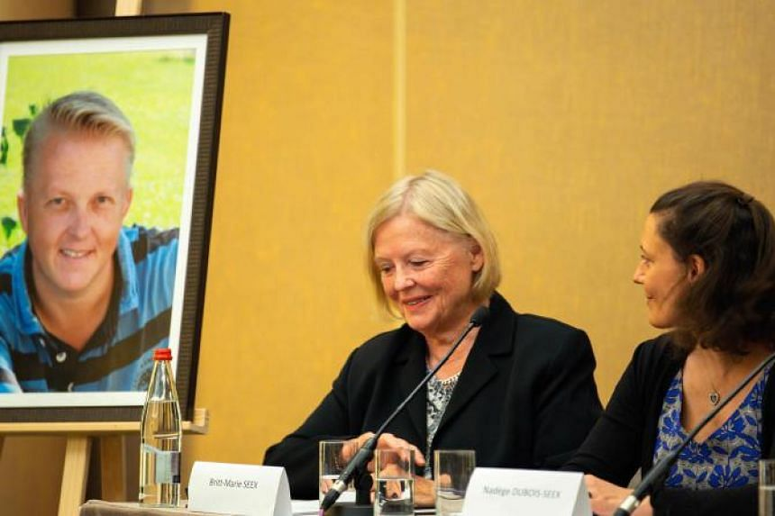 Britt-Marie Seex (centre) gestures as she addresses a press conference with Nadege Dubois-Seex in Paris on May 21, 2019, alongside a portrait of the late Jonathan Seex.