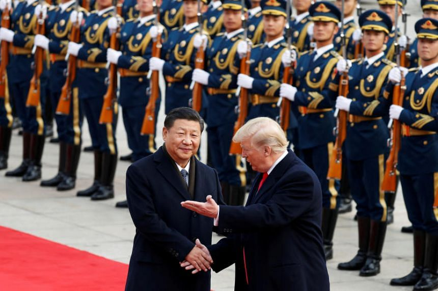 US President Donald Trump takes part in a welcoming ceremony with China's President Xi Jinping in Beijing, on Nov 9, 2017.