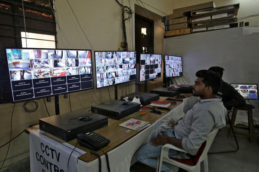 Election staff members monitor screens connected to CCTV cameras set up in and outside vote counting centres in Ahmedabad, India, on May 21, 2019.
